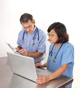 Doctor and Nurse looking at a laptop screen
