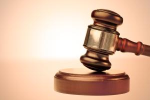 Judge's gavel and round block