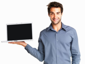 Smiling man in a blue shirt holding a laptop with a blank screen