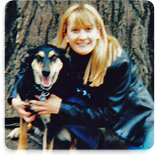 Erica Schouviller, Champ Software Accounting/Office Supervisor next to a tree with a German Shepherd dog