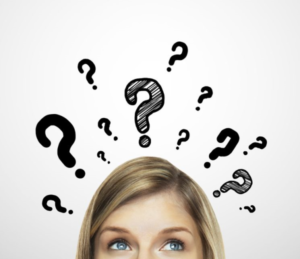Woman with hand written question marks around her head, depicting she has questions