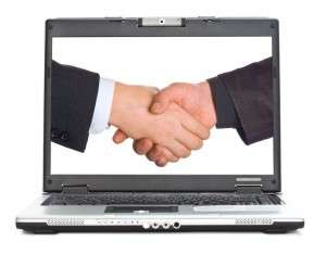 Laptop screen showing two men shaking hands, depicting HR Vendor Networking