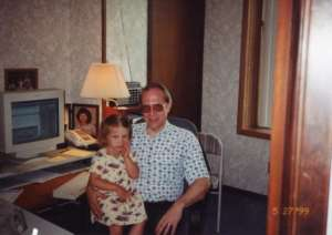 Dave Rosebaugh and Libby, sat at a computer in 1999