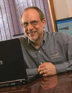 Dave Rosebaugh sat at a Computer