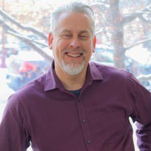 David Smith, Champ Software Senior Account Executive stood by a tree