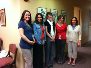 Five members of the Douglas County WI ADRC stood by a wall