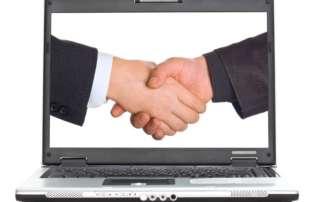 Laptop screen showing two men shaking hands, depicting HR Vendor Networking