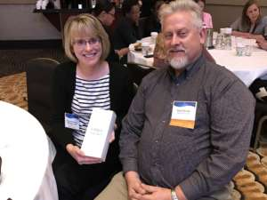 David Smith Champ Software Senior Account Executive and Margaret Sturgis, winner of the FitBit at the 2016 MPPH Conference
