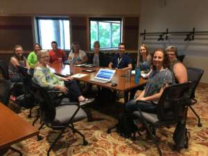 10 people sat round a table at the Champ Software Onsite Minnesota User Group