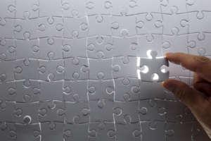 The final jigsaw piece completing a blank jigsaw