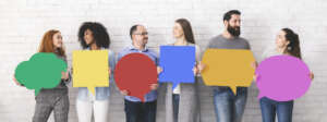 People holding speech bubbles sharing ideas